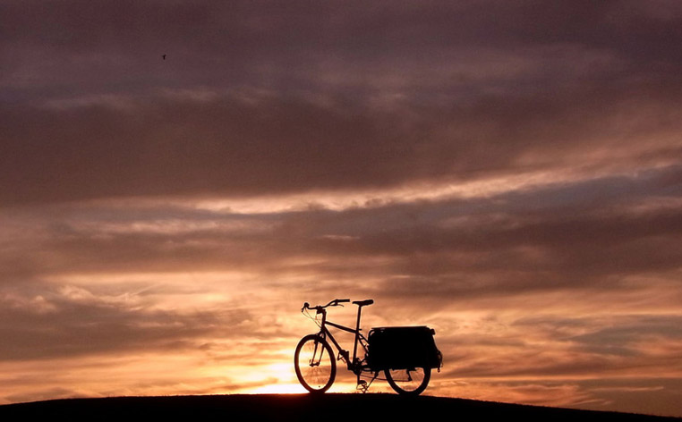 An Xtracycle on a hill at sunset