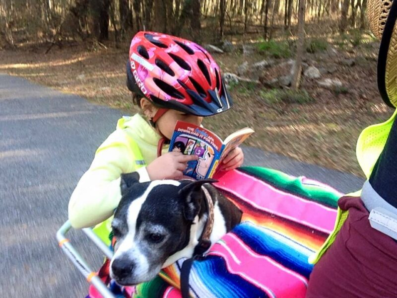 Kid and dog on an Xtracycle cargo bike